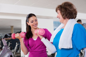 Mature Woman With Her Physical Trainer At the Gym